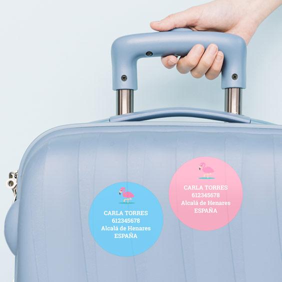 Etiquetes adhesives rodones per a maletes
